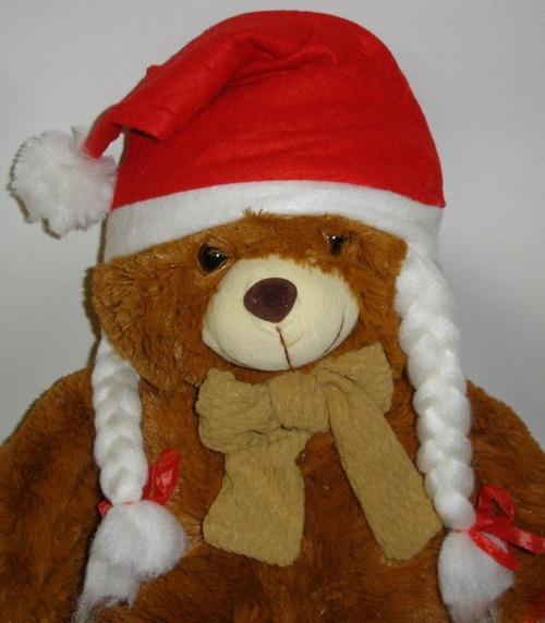 Weihnachtsmütze mit Bommel und Zöpfen