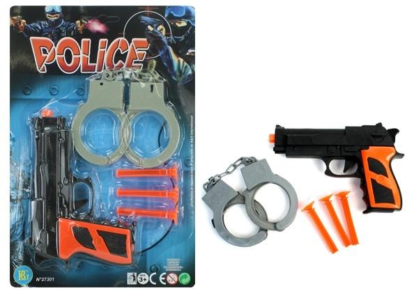 Pfeilpistole und Handschellen auf Karte ca 29x19cm